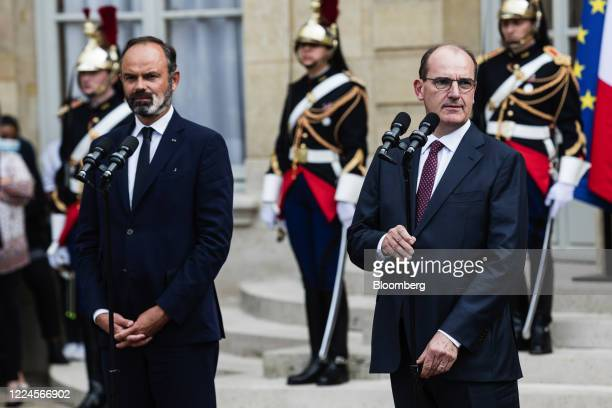 Jean Castex Frances new prime minister right pauses while delivering a speech beside Edouard Philippe France's former prime minister during a...