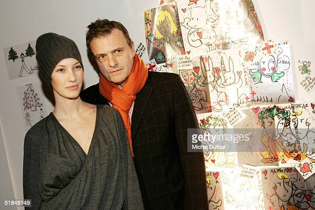 Jean Charles de Castelbajac and Mareva Galanter attend a private party featuring christmas trees created by fashion designers held at the Centre...