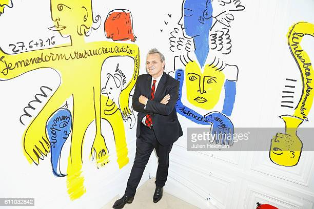 Jean Charles de Castelbajac is pictured during his Book Signing with the paintings he did on the wall for the launch of his book as part of the Paris...