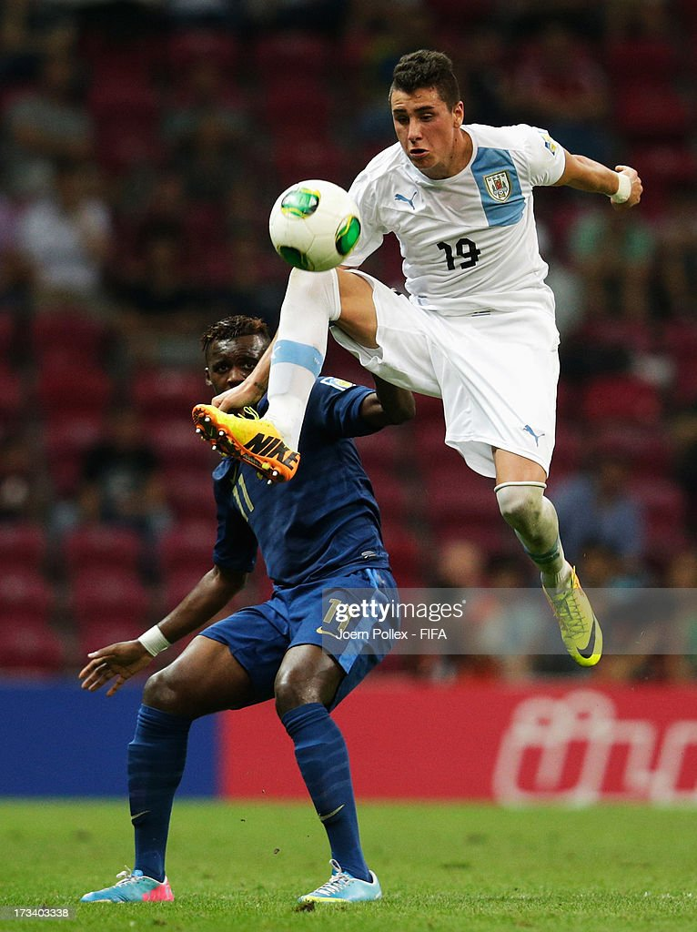 Jean Christophe Bahebeck (L) of France and Jose Gimenez of Uruguay compete for the ball during the FIFA U-20 World Cup Final match between France and Uruguay at Ali Sami Yen Arena on July 13, 2013 in Istanbul, Turkey.