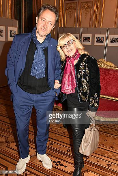 Jean Christophe Molinier and Nicoletta attend the Massimo Gargia's Photos of Celebrities Exhibition at Mairie du 8eme Paris Fashion Week Womenswear...