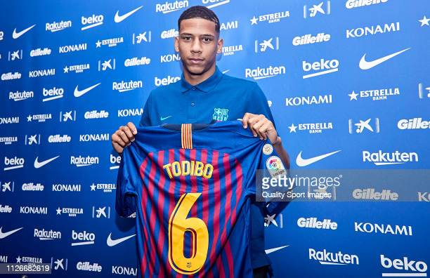 Jean Claire Todibo poses with the FC Barcelona shirt during his unveiling at Nou Camp on February 01, 2019 in Barcelona, Spain.
