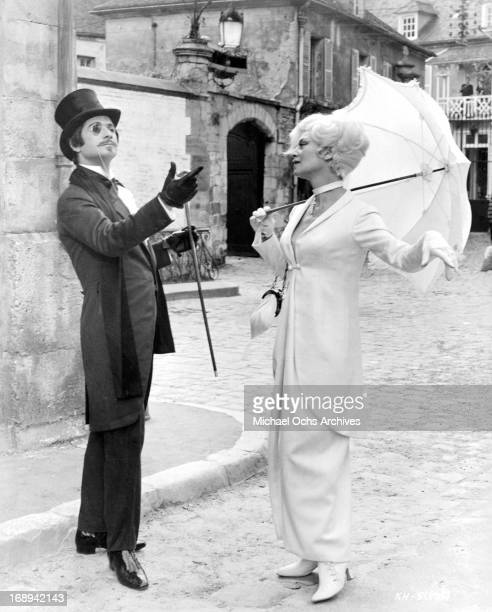 Jean Claude Brialy greets Franoise Christophe in a scene from the film 'King Of Hearts' 1966
