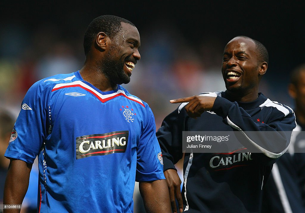 Jean Claude Darcheville of Rangers shares a joke with Damarcus Beasley of Rangers after The Clydesdale Bank Scottish Premier League match between Rangers and Dundee United at Ibrox Stadium on May 10, 2008 in Glasgow, Scotland.