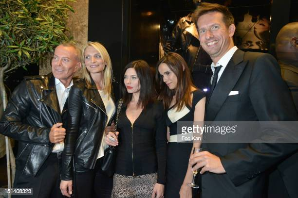 PARIS FRANCE SEPTEMBER Jean Claude Jitrois Sarah Marshall Delphine Chaneac Melissa Mars and Sam Bobino pose at the Jean Claude Jitrois Shop during...