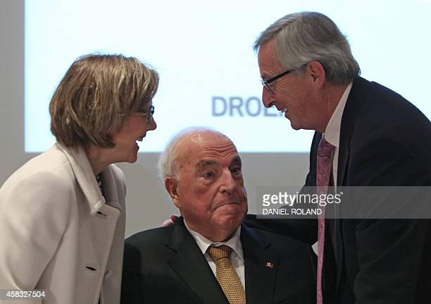 Jean Claude Juncker President of the European Commission former German Chancellor Helmut Kohl and his wife Maike KohlRichter attend the presentation...