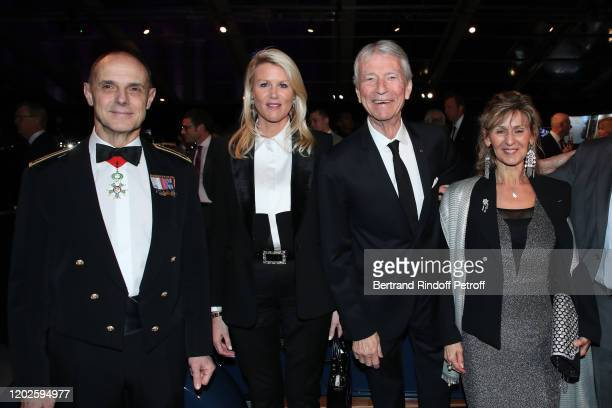 Jean Claude Narcy and Alice Bertheaume standing between Military Governor of Paris General Bruno Le Ray and his wife Agnes Le Ray attend the 35th...