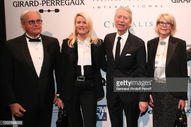 Jean Claude Narcy and Alice Bertheaume standing between President of the International Automobile Festival Remi Depoix and his wife Veronique Depoix...
