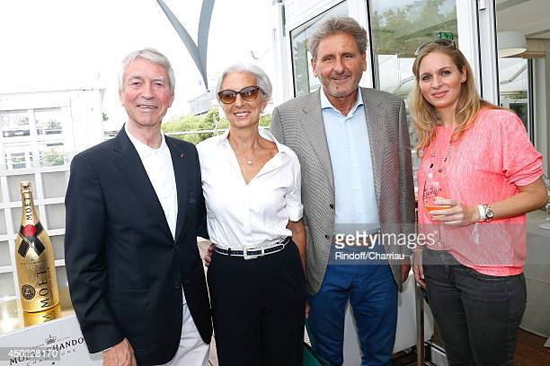 Jean Claude Narcy IMF Managing Director Christine Lagarde her husband Xavier Giocanti and Laure Brovelli attend the Roland Garros French Tennis Open...