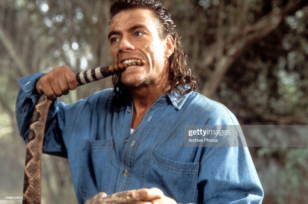 Here's action man Jean Claude Van Damme on set and eating a snake in 1993.