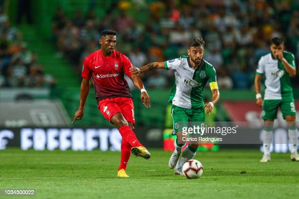 Jean Cleber of CS Maritimo vies with Bruno Fernandes of Sporting CP for the ball possession during the Portuguese League Cup match between Sporting...