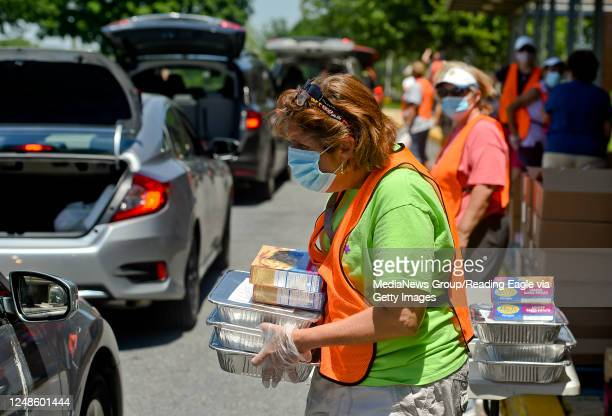 Jean Condos carries food to a car at the Brandywine Heights Intermediate and Middle School in Topton Tuesday afternoon June 9, 2020 where Helping...