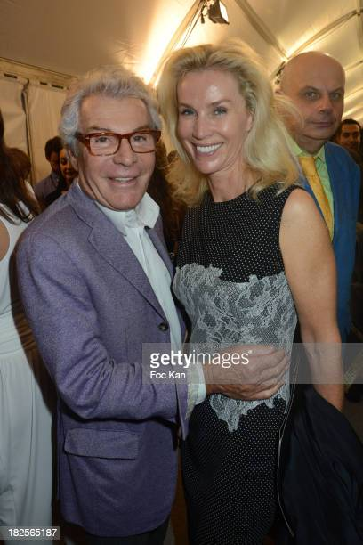 Jean Daniel Lorieux and Laura Restelli Brizard attend the Elie Saab show as part of the Paris Fashion Week Womenswear Spring/Summer 2014 at the...