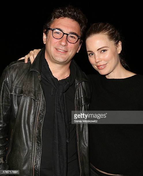 Jean David Blanc and Melissa George attend Domingo Zapata's A Contemporary Salon event on August 17 2013 in Watermill New York