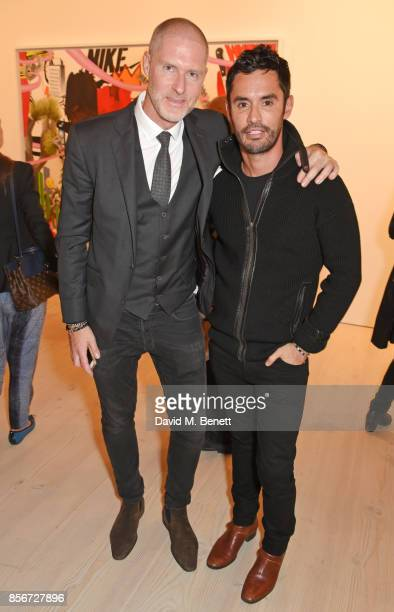 Jean David Malat and JeanBernard FernandezVersini attend a private view of 'Philip Colbert New Paintings' at The Saatchi Gallery on October 2 2017 in...
