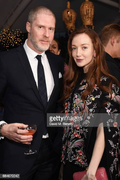 Jean David Malat and Olivia Grant attend the Gentleman's Journal Bermuda 35th America's Cup summer party hosted by Jack Guinness at Ham Yard Hotel on...