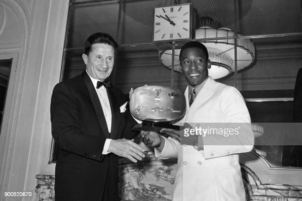 Jean de Beaumont president of the French Olympic Committee awards on April 2 1971 Brazilian football star Pelé with the Sports Academy prize in Paris...