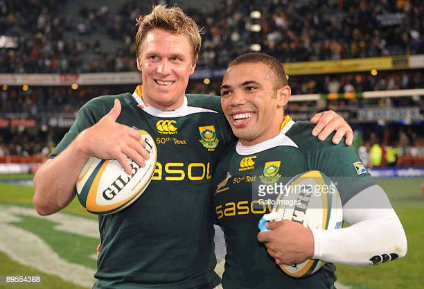 Jean de Villiers and Bryan Habana of South Africa celebrate their 50th caps during the Tri Nations match between South Africa and the All Blacks at...