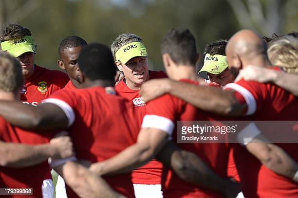Jean de Villiers and team mates embrace during a South African Springboks training session at Churchie on September 3 2013 in Brisbane Australia