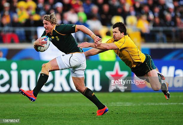 Jean de Villiers of South Africa breaks clear from the flying challange of Adam AshleyCooper of Australia during quarter final three of the 2011 IRB...