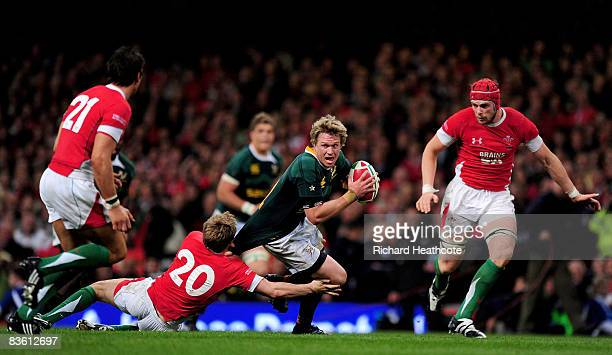 Jean De Villiers of South Africa is tackled by Dwayne Peel of Wales during the Invesco Perpetual Series match between Wales and South Africa at the...