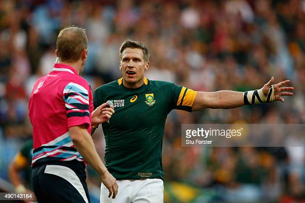 Jean De Villiers of South Africa talks to referee Wayne Barnes during the 2015 Rugby World Cup Pool B match between South Africa and Samoa at Villa...