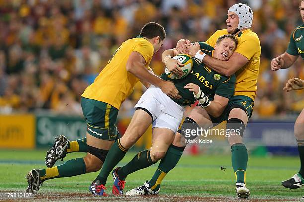 Jean de Villiers of the Springboks is tackled by Ben Mowen of the Wallabies during The Rugby Championship match between the Australian Wallabies and...
