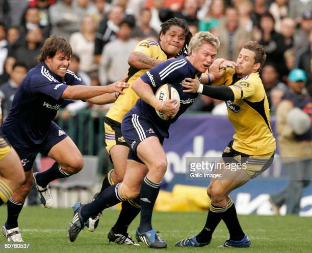 Jean de Villiers of the Stormers attacks during the Super 14 match between the Stormers and the Hurricanes at Newlands Stadium April 19 2008 in Cape...