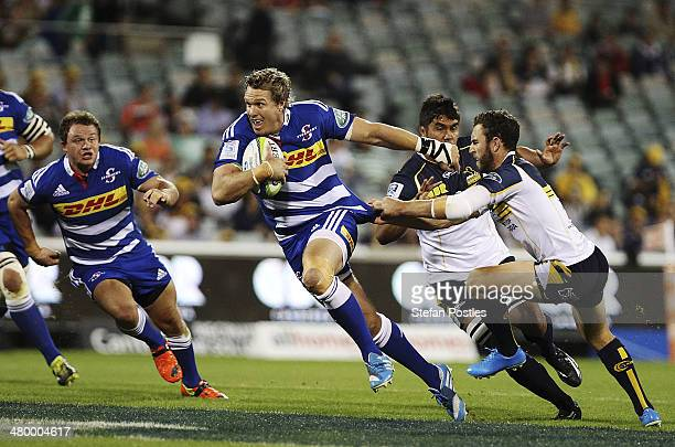 Jean de Villiers of the Stormers breaks through the Brumbies line during the round six Super Rugby match between the Brumbies and the Stormers at...