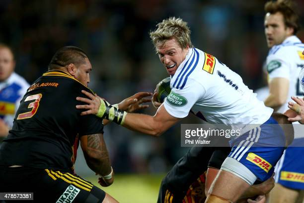 Jean De Villiers of the Stormers fends off Ben Tameifuna of the Chiefs during the round five Super Rugby match between the Chiefs and the Stormers at...