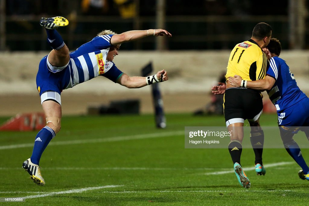 Jean de Villiers of the Stormers misses a tackle on Matt Proctor of the Hurricanes during the round 11 Super Rugby match between the Hurricanes and the Stormers at FMG Stadium on April 26, 2013 in Palmerston North, New Zealand.