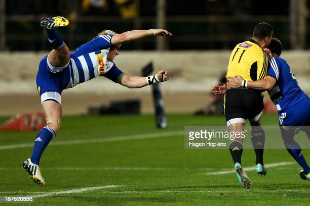 Jean de Villiers of the Stormers misses a tackle on Matt Proctor of the Hurricanes during the round 11 Super Rugby match between the Hurricanes and...