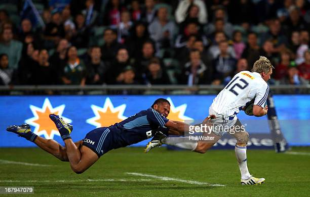 Jean De Villiers of the Stormers scores a try in the tackle of Frank Halai of the Blues during the round 12 Super Rugby match between the Blues and...