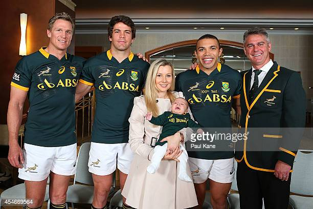 Jean de Villiers Warren Whiteley Janine Habana Bryan Habana and Heyneke Meyer pose before the South Africa Springboks captain's run at the Duxton...
