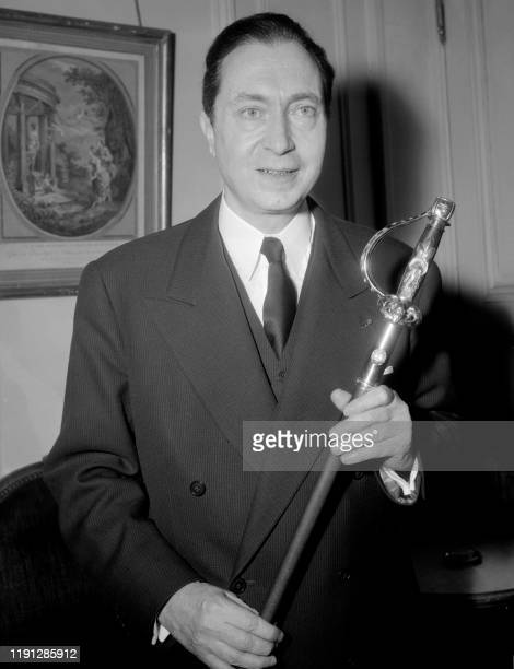 Jean Delay poses with his academician sword, January 08, 1960 in Paris. - Born in Bayonne on November 14 Jean Delay passed his baccalaureate at the...