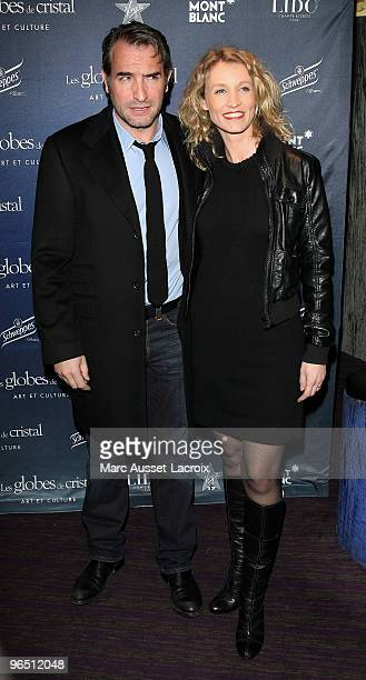 Jean Dujardin and Alexandra Lamy poses at the Ceremony of Globe de Cristal 2010 Awards at Le Lido on February 8 2010 in Paris France