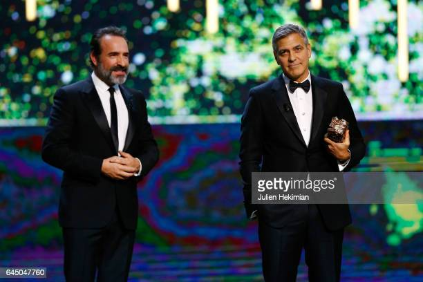 Jean Dujardin and George Clooney are seen on stage during the Cesar Film Awards Ceremony at Salle Pleyel on February 24 2017 in Paris France