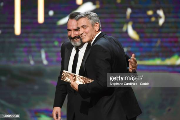 Jean Dujardin and George Clooney during the Cesar Film Awards 2017 ceremony at Salle Pleyel on February 24 2017 in Paris France