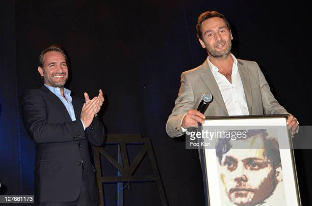 Jean Dujardin and Gilles Lellouche and guests attend the 'Romy Schneider and Patrick Dewaere Awards 2011 Ceremony at the Bon Marche on April 4 2011...