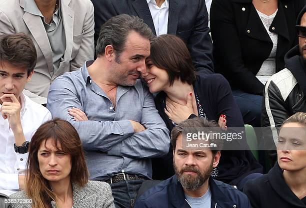 Jean Dujardin and his partner Nathalie Pechalat attend the Men's Singles final between Novak Djokovic of Serbia and Andy Murray of Great Britain on...