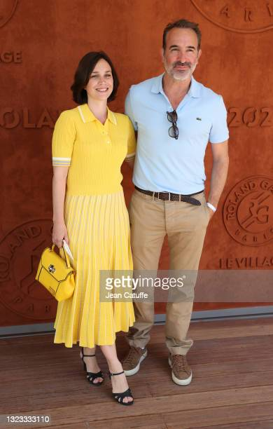 Jean Dujardin and his wife Nathalie Pechalat attend the Men's Singles Final during day 15 of the 2021 Roland-Garros, French Open, a Grand Slam tennis...