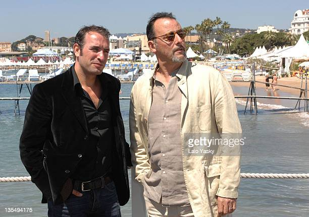 Jean Dujardin and Jean Reno during 2007 Cannes Film Festival Cash Photocall at Palais des Festival in Cannes France