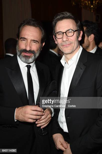 Jean Dujardin and Michel Hazavanicius attend the Cesar Dinner at Le Fouquet's on February 24 2017 in Paris France