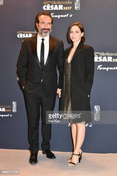 Jean Dujardin and Nathalie Pechalat attend the Cesar's Dinner at Le Fouquet's on February 24 2017 in Paris France