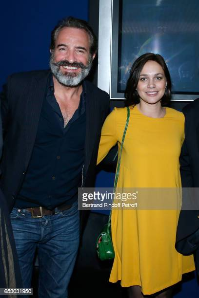 Jean Dujardin and Nathalie Pechalat attend the Chacun sa vie Paris Premiere at Cinema UGC Normandie on March 13 2017 in Paris France