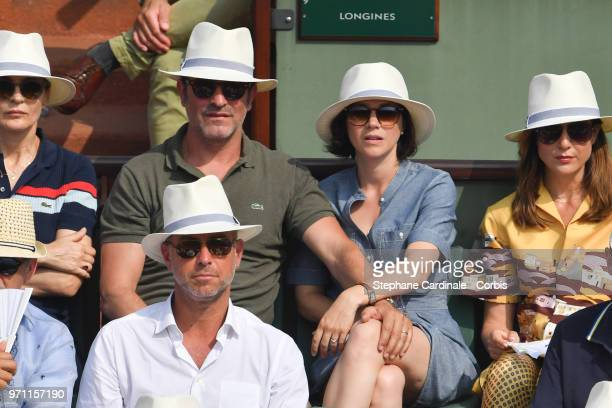 Jean Dujardin and Nathalie Pechalat attend the Men Final of the 2018 French Open Day Fithteen at Roland Garros on June 10 2018 in Paris France