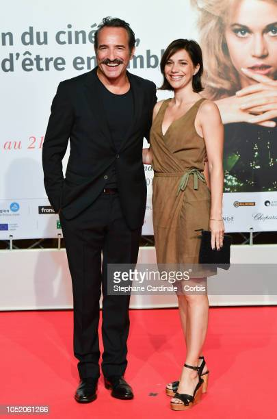 Jean Dujardin and Nathalie Pechalat attend the opening ceremony during the 10th Film Festival Lumiere on October 13 2018 in Lyon France