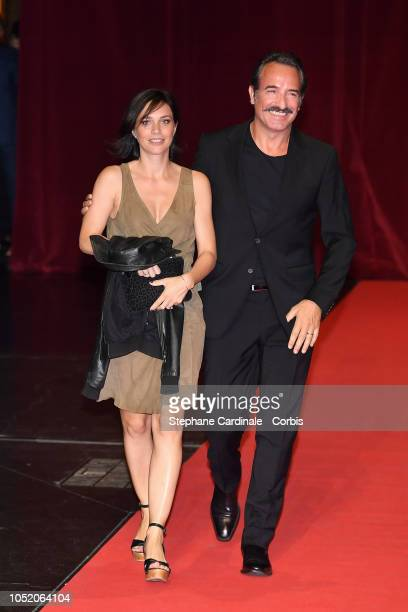 Jean Dujardin and Nathalie Pechalat attend the opening ceremony during the 10th Film Festival Lumiere on October 13, 2018 in Lyon, France.