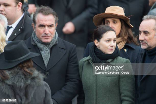 Jean Dujardin and Nathalie Pechalat leave the church after Johnny Hallyday's Funeral at Eglise De La Madeleine on December 9 2017 in Paris France...