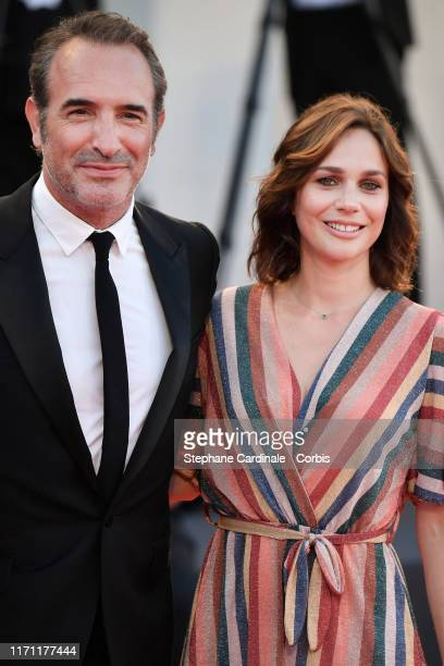 Jean Dujardin and Nathalie Pechalat walksthe red carpet ahead of the J'Accuse screening during the 76th Venice Film Festival at Sala Grande on August...
